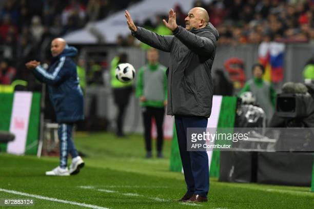 Russia's coach Stanislav Cherchesov and Argentina's coach Jorge Sampaoli gesture from the touchline during an international friendly football match...