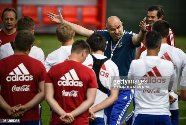Russia's coach Stanislav Cherchesov gestures as he talks to the palyers during a training session in Novogorsk outside Moscow on June 26 ahead of the...