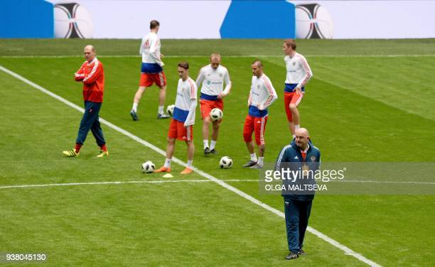 Russia's coach Stanislav Cherchesov leads a training session of his team at the St Petersburg stadium on March 26, 2018 on the eve of the friendly...