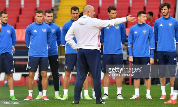 Russia's coach Stanislav Cherchesov speaks to players during a training session in Moscow on June 20 2017 on the eve of the 2017 Confederations Cup...