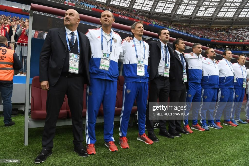 Russia's coach Stanislav Cherchesov (L), staff and players line up before the Russia 2018 World Cup Group A football match between Russia and Saudi Arabia at the Luzhniki Stadium in Moscow on June 14, 2018. (Photo by Kirill KUDRYAVTSEV / AFP) / RESTRICTED