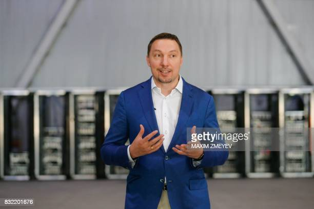 Russia's cryptobusinessman Dmitry Marinichev speaks during an AFP interview at his virtual currencies mining farm in a former Sovietera car factory...