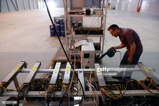 Russia's cryptobusinessman Dmitry Marinichev's virtual currencies mining farm operates in a former Sovietera car factory warehouse in Moscow July 26...