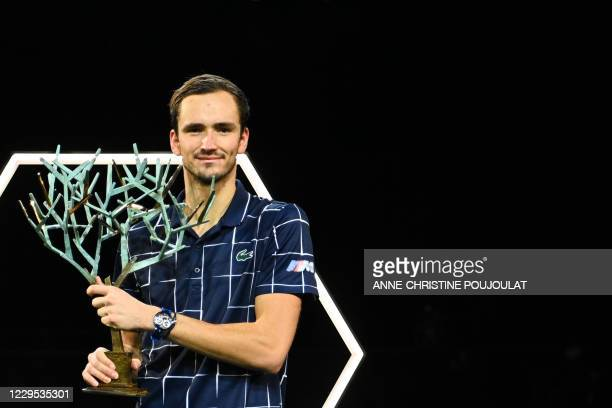 Russia's Daniil Medvedev celebrates with the trophy after winning his men's singles final tennis match against Germany's Alexander Zverev, on day 7...