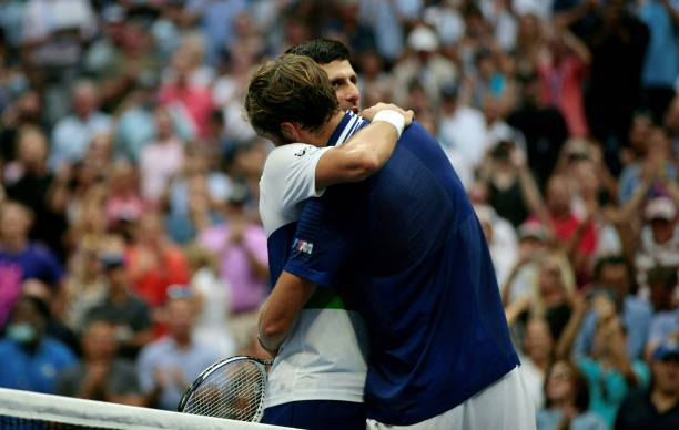 Russia's Daniil Medvedev greets Serbia's Novak Djokovic at the net after winning during their 2021 US Open Tennis tournament men's final match at the...