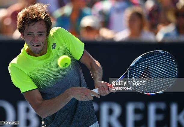 Russia's Daniil Medvedev hits a return against Australia's Thanasi Kokkinakis during their men's singles first round match on day two of the...