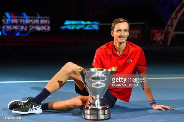 Russia's Daniil Medvedev poses with the trophy after winning the St. Petersburg Open tennis tournament final match against Croatia's Borna Coric in...