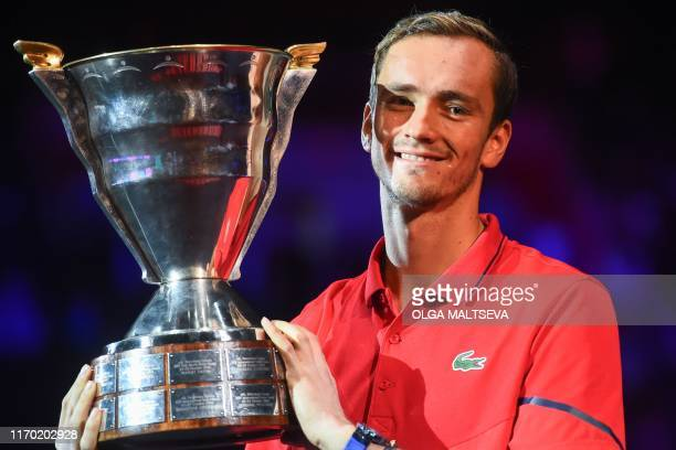Russia's Daniil Medvedev poses with the trophy after winning the St Petersburg Open tennis tournament final match against Croatia's Borna Coric in...