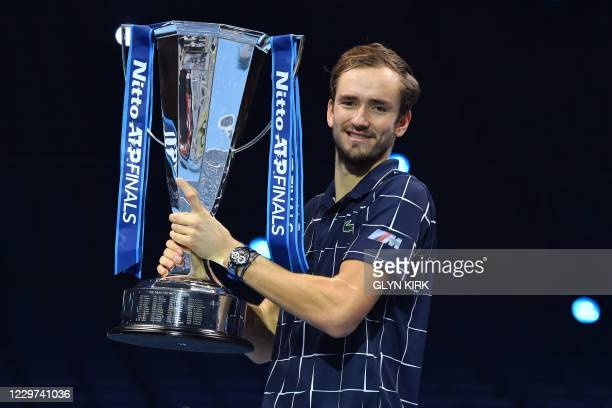 Russia's Daniil Medvedev poses with the winner's trophy after his 4-6, 7-6, 6-4 win over Austria's Dominic Thiem in their men's singles final match...
