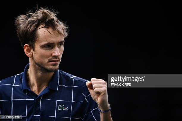 Russia's Daniil Medvedev reacts as he plays against Argentina's Diego Schwartzman during their men's singles quarter-final tennis match on day 5 at...