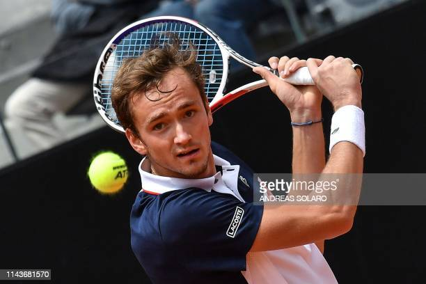 Russia's Daniil Medvedev returns the ball to Australia's Nick Kyrgios during their ATP Masters tournament tennis match at the Foro Italico in Rome on...