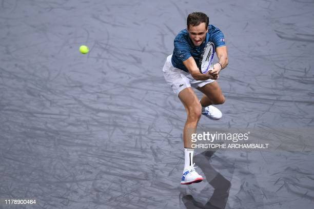 Russia's Daniil Medvedev returns the ball to France's Jeremy Chardy during their men's singles tennis match on day two of the ATP World Tour Masters...
