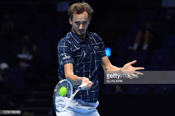 Russia's Daniil Medvedev returns to Austria's Dominic Thiem during their men's singles final match on day eight of the ATP World Tour Finals tennis...