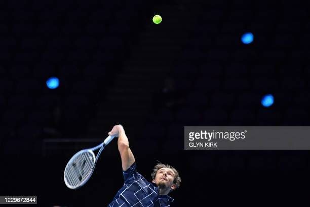 Russia's Daniil Medvedev serves to Serbia's Novak Djokovic during their men's singles round-robin match on day four of the ATP World Tour Finals...