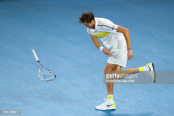 Russia's Daniil Medvedev throws his racquet as he plays against Serbia's Novak Djokovic during their men's singles final match on day fourteen of the...