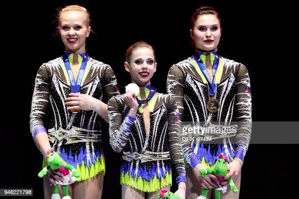 Russia's Daria Chebulanka Polina Plastinina and Kseniia Zagoskina pose on the podium with their gold medals during the Acrobatic Gymnastics World...
