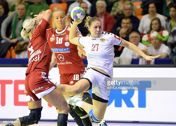 Russia's Daria Dmitrieva aims to score a goal next to Hungary's Krisztina Triscsuk and Piroska Szamoránsky during the match Hungary vs Russia at the...