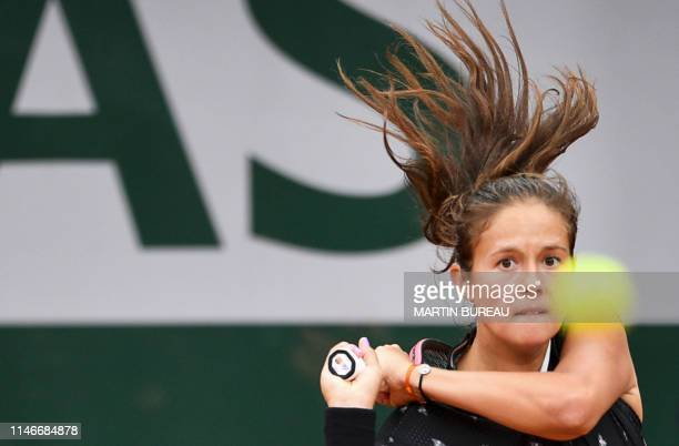 Russia's Daria Kasatkina eyes the ball as she plays against Italy's Jasmine Paolini during their women's singles first round match on day three of...