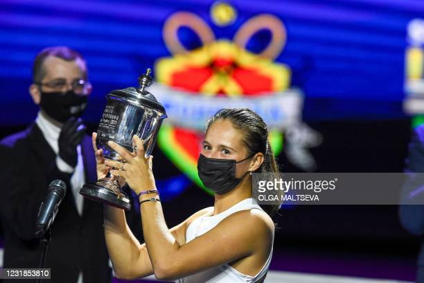 Russia's Daria Kasatkina poses with the trophy after her final tennis match against Russia's Margarita Gasparyan at the Saint-Petersburg Ladies...