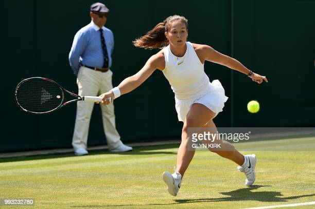 Russia's Daria Kasatkina returns against Australia's Ashleigh Barty during their women's singles third round match on the sixth day of the 2018...