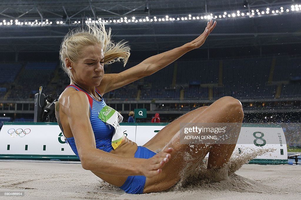 TOPSHOT - Russia's Dariya Klishina competes in the Women's Long Jump Qualifying Round during the athletics event at the Rio 2016 Olympic Games at the Olympic Stadium in Rio de Janeiro on August 16, 2016. / AFP / Adrian DENNIS
