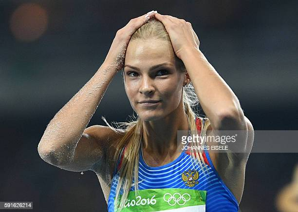 Russia's Darya Klishina reacts after a jump during the Women's Long Jump Final of the athletics event at the Rio 2016 Olympic Games at the Olympic...