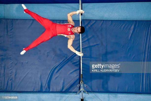Russia's David Belyavskiy competes in the horizontal bar event of the men's apparatus final of the Artistic Gymnastics at the 2019 European Games in...
