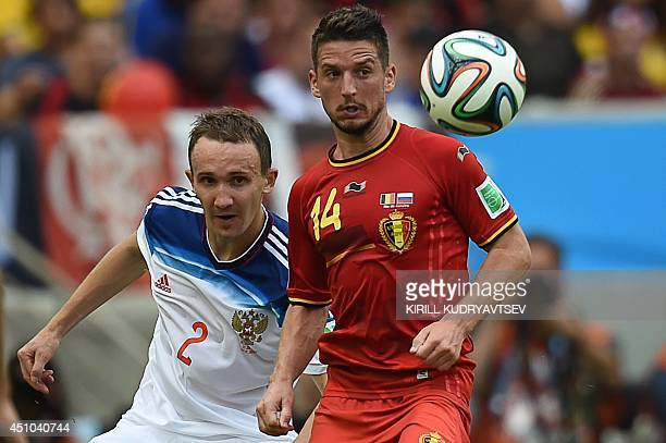 Russia's defender Alexei Kozlov fights for the ball with Belgium's forward Dries Mertens during a Group H football match between Belgium and Russia...
