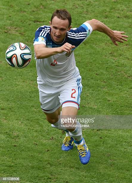 Russia's defender Alexei Kozlov runs for the ball during the Group H football match between Belgium and Russia at The Maracana Stadium in Rio de...