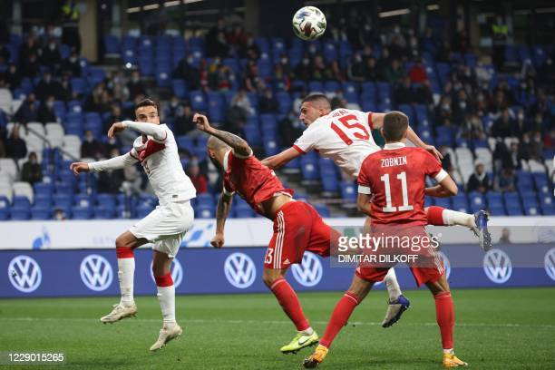 Russia's defender Fyodor Kudryashov and Turkey's defender Merih Demiral vie for the ball during the UEFA Nations League football match between Russia...