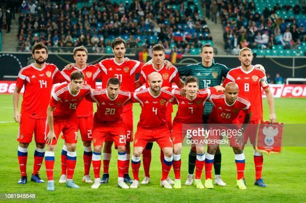 Russia's defender Georgiy Dzhikiya Russia's midfielder Kirill Nababkin and Russia's midfielder Aleksandr Erokhin Russia's defender Roman Neustadter...