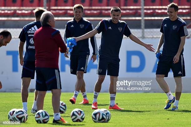 Russia's defender Georgy Shchennikov and Russia's defender Aleksei Kozlov take part a training session at Estadio Novelli Jr in Itu on June 20 2014...