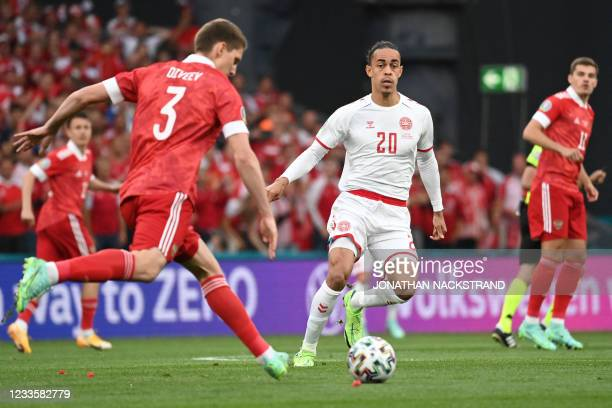 Russia's defender Igor Diveev fights for the ball with Denmark's forward Yussuf Poulsen during the UEFA EURO 2020 Group B football match between...