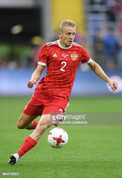 Russia's defender Igor Smolnikov controls the ball during a friendly football match between Russia and Chile at the CSKA Arena in Moscow on June 9...