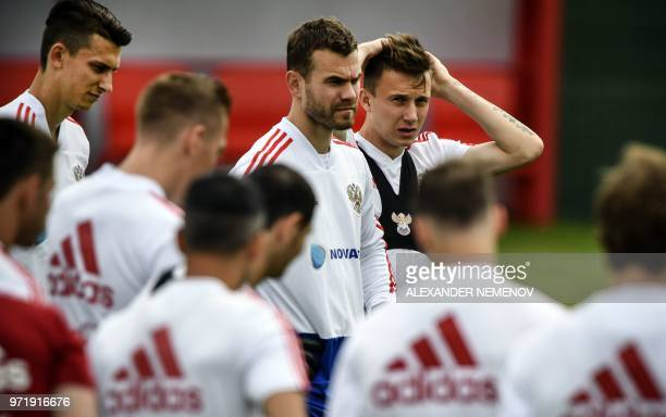Russia's defender Ilya Kutepov Russia's goalkeeper Igor Akinfeev and Russia's midfielder Alexander Golovin attend a training session in Novogorsk...