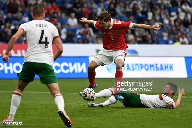 Russia's defender Mario Fernandes and Bulgaria's midfielder Petar Vitanov in action during the friendly football match Russia v Bulgaria in Moscow on...