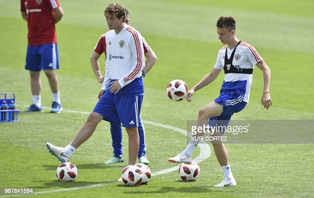 Russia's defender Mario Fernandes and teammate defender Andrey Semyonov attend a training session in Novogorsk outside Moscow on June 30 during the...