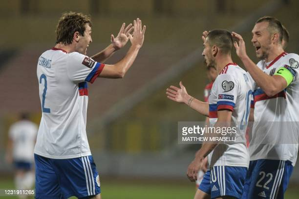 Russia's defender Mario Fernandes celebrates after scoring Russia's second goal during the FIFA World Cup Qatar 2022 Group H qualification football...