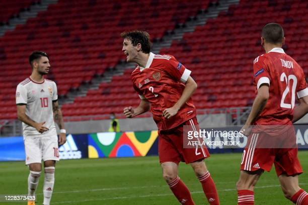 Russia's defender Mario Fernandes celebrates scoring with his teammates during the UEFA Nations League football match between Hungary and Russia on...
