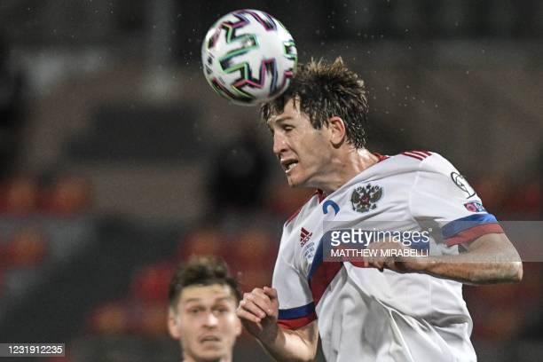 Russia's defender Mario Fernandes goes for a header during the FIFA World Cup Qatar 2022 Group H qualification football match between Malta and...