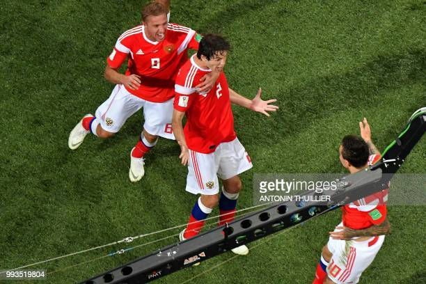 Russia's defender Mario Fernandes is congratulated by teammates after scoring a goal during the Russia 2018 World Cup quarterfinal football match...