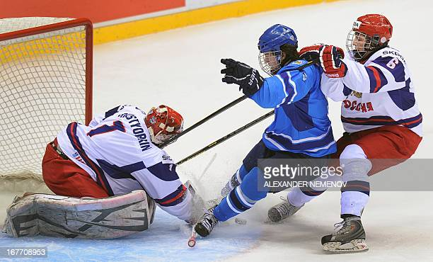 Russia's defender Nikolai Demidov stops Finland's forward Jonatan Tanus attacking Russia's goalie Igor Shestyorkin during a bronze medal game of the...