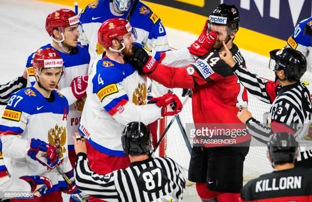 TOPSHOT Russia´s defender Vladislav Gavrikov and Canada´s forward Sean Couturier scuffle during the IIHF Men's World Championship Ice Hockey...