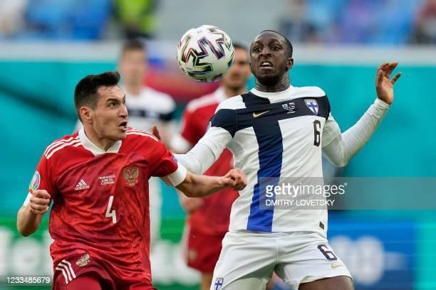 Russia's defender Vyacheslav Karavaev and Finland's midfielder Glen Kamara vie during the UEFA EURO 2020 Group B football match between Finland and...