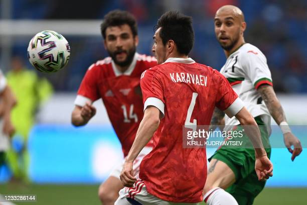 Russia's defender Vyacheslav Karavayev eyes the ball during the friendly football match Russia v Bulgaria in Moscow on June 5 in preparation for the...