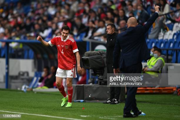 Russia's defender Vyacheslav Karavayev reacts during the friendly football match Russia v Bulgaria in Moscow on June 5 in preparation for the UEFA...