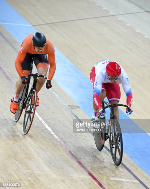 Russia's Denis Dmitriev competes for the gold medal in the men's sprint final with Harrie Lavreysen of the Netherlands at the 2017 Track Cycling...