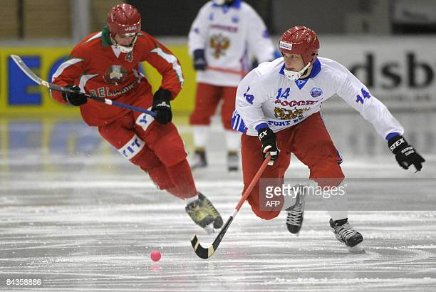 Russia's Denis Kriushenkov dribbles past Belarus's Dzmitry Pashaliyk during their Bandy World Championship group match on January 19 2009 at the ABB...
