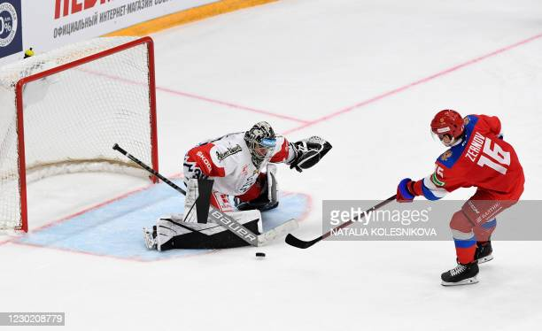 Russia's Denis Zernov tries to score during the Channel One Cup of the Euro Hockey Tour ice hockey match between Russia and Czech Republic at CSKA...