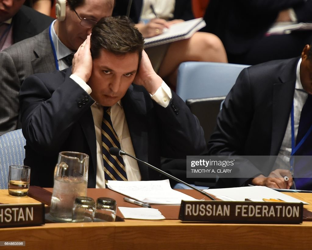 TOPSHOT - Russia's deputy UN ambassador, Vladimir Safronkov attends the United Nations Security Council meet in an emergency session at the UN on April 5, 2017 in New York, about the suspected deadly chemical attack that killed civilians, including children, in Syria. /